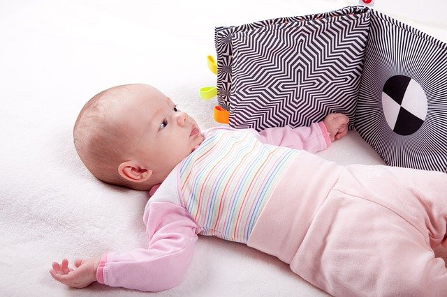 A baby lying on a bed