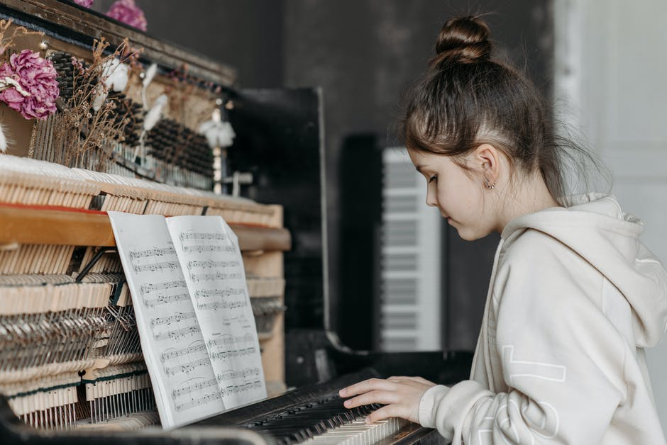 A person standing in front of a piano keyboard